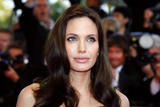 Angelina Jolie in gree low-cut dress shows her pregnant belly and big breasts at Kung Fu Panda premiere during the 61st International Cannes Film Festival in Cannes